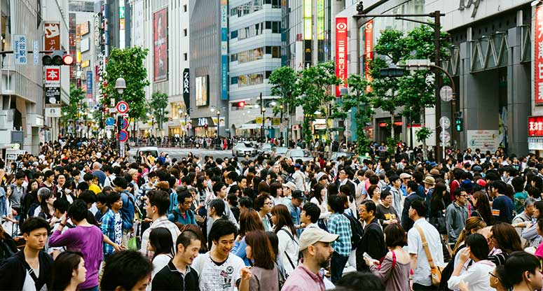 big crowd of people in an outdoor mall in Tokyo Japan