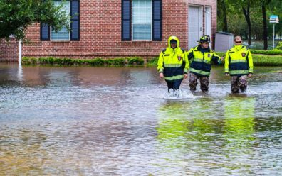 police men responding during disaster recovery city plan business continuity walking in flooded streets