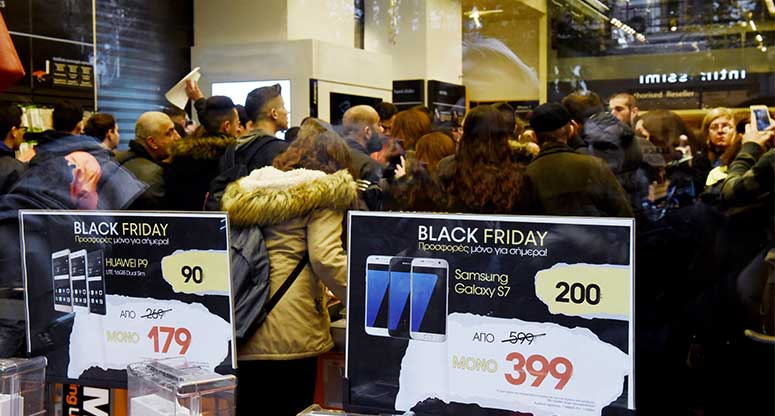 people at a retail store on black Friday cyber Monday